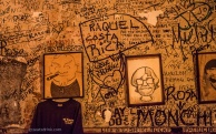 The wall above the bar, featuring character portraits. Owner David Jones is on the left. Notice the resemblance?