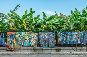 Artwork hanging on the fence surrounding Jackson Square.
